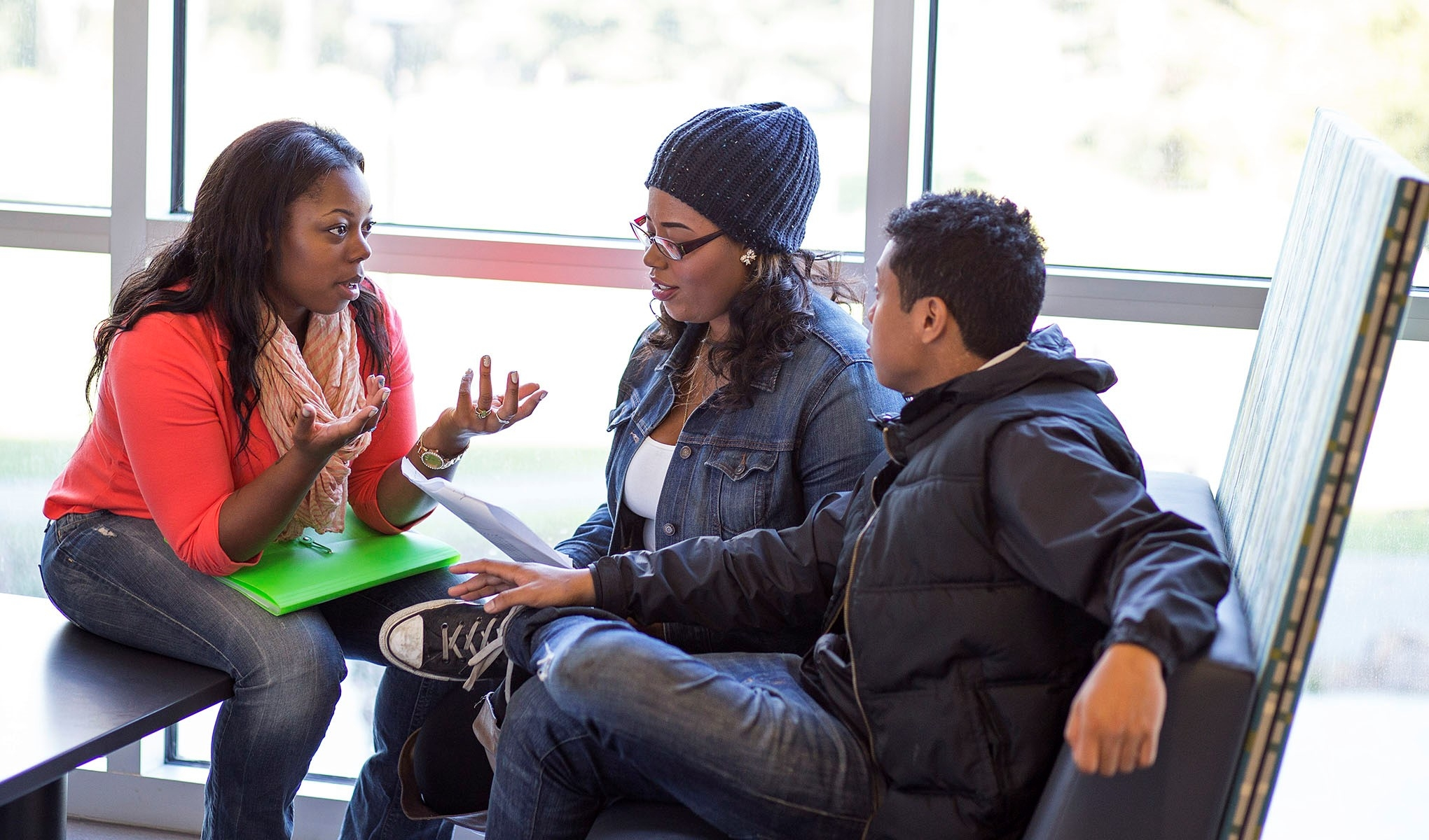 Metro student Kayla Jackson discusses a math problem with Metro students Ivanna Carroll and Henry Eik.