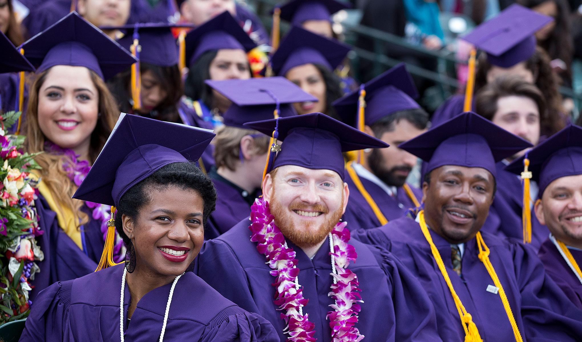 A photo of San Francisco State graduates in academic regalia.