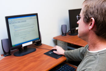 Photo of a man using a computer in the Career Center.