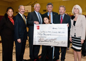 A photo of dignitaries from the San Francisco Mayor's Office, San Francisco Unified School District, Wells Fargo Bank and San Francisco State University, and a Martin Luther King Middle School student, with a check from Wells Fargo to SF Promise.