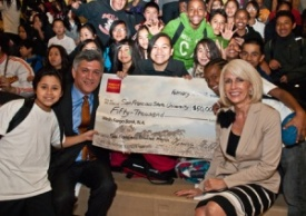 A photo of Wells Fargo representatives and Martin Luther King Middle School students with a check from Wells Fargo to SF Promise.