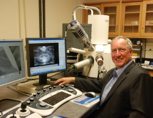 A photo Electron Microscopy Facility Manager Clive Hayzelden sitting at the controls of the Carl Zeiss Ultra55 field emission scanning electron microscope