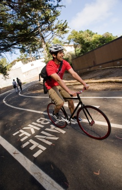 A photo of students using the bike path on campus.