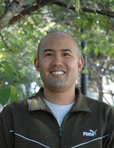 A photo of Patrick Lapid, hood recipient for graduate studies