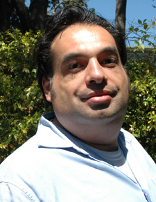 A photo of Abraham Aviles-Scott, hood recipient for the College of Health and Human Services
