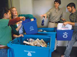 A photo of students sorting recycling.