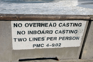A photo of a sign at the Pacifica Pier that reads