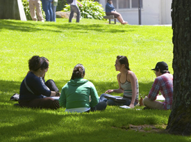 A photo of SF State students sitting on the quad.