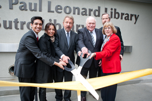 A photo of SF State Associated Students President Andrew Gutierrez; alumna Neda Nobari; President Robert A. Corrigan; David Leonard, son of former SF State President J. Paul Leonard; Brian Cahill, executive vice president of operations for Balfour Beatty Construction; and SF State Librarian Debbie Masters cutting the ribbon at the new J. Paul Leonard Library on April 10, 2012.