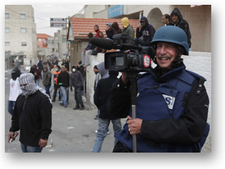 A photo of SF State Professor Ken Kobré covering a clash between Palestinian youth and Israeli soldiers outside Jerusalem for his film,