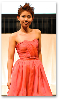 A photo of a student modeling clothing during the 2011 SF State student fashion show.